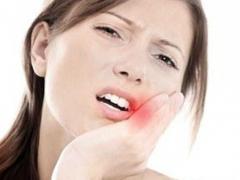 болит десна после лечения зуба